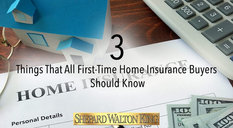 Home insurance form and dollars on the table.